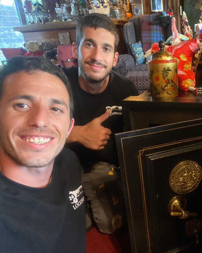 image of Saul and Eden with an antique safe they worked on