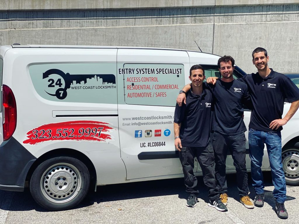 Saul, Omri, and Eden in front of their locksmith van.